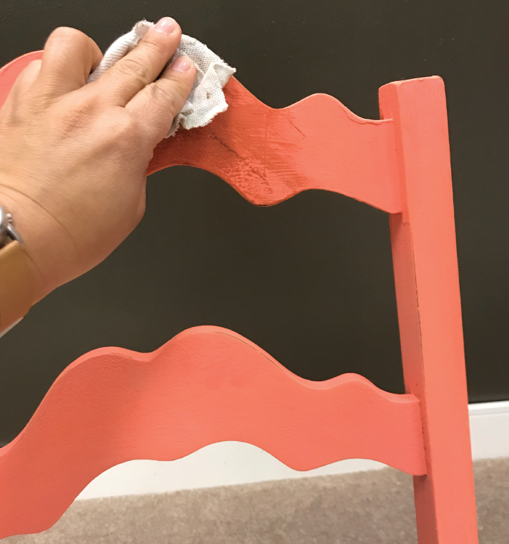 Wax being applied to a newly painted chair.