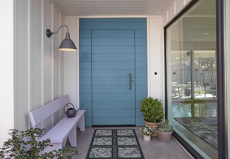 An entry with a blue colored door painted in Blueprint and purple colored bench painted in Standing Ovation.
