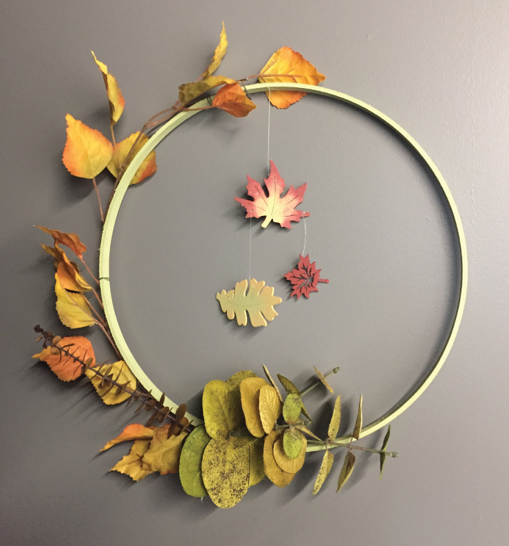 A fall decorative wreath for placement on a door or wall.