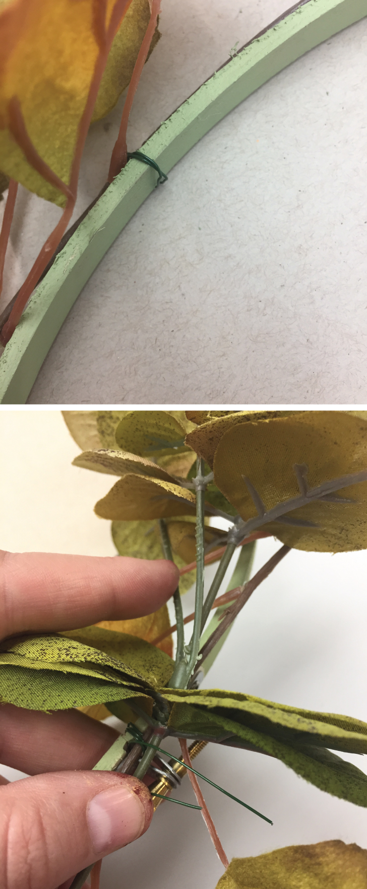 Pictures showing wire wrapped around the hoop holding a leaf in place.