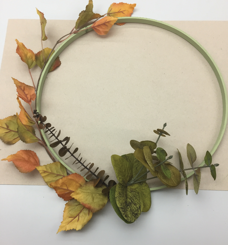 The decorative fall wreath with the plastic leaves added.