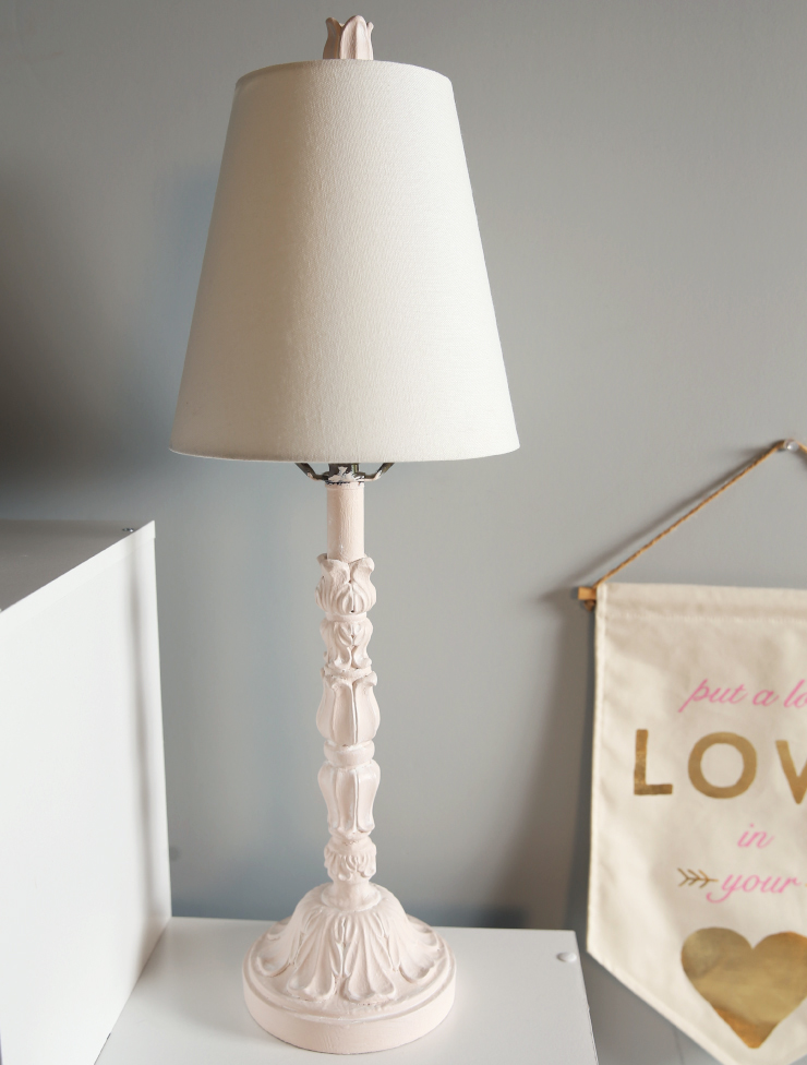 An antique lamp after it has been made over with new paint and new shade.