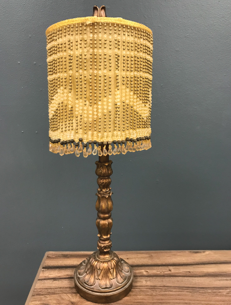A before photo and an old lamp.