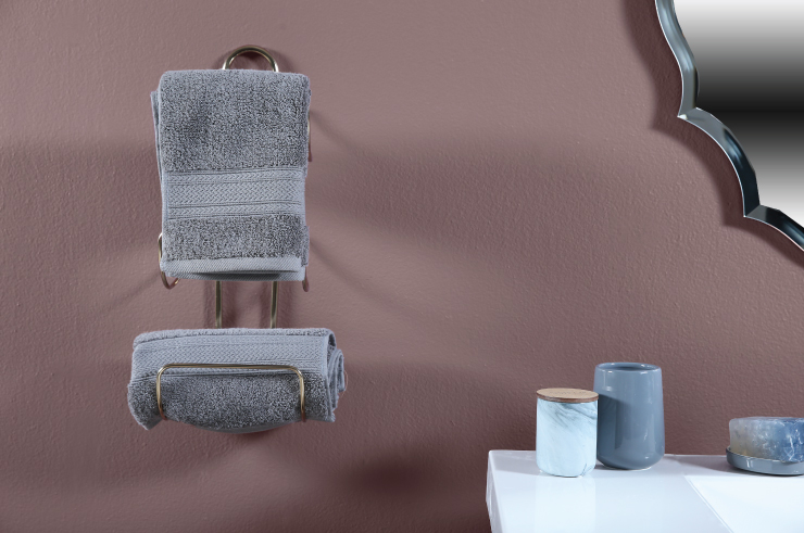Detail shot of grey towels against Raisin in the Sun wall color.
