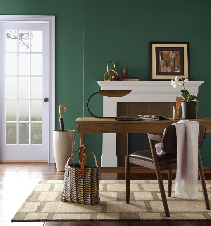 A home office with the walls painted in Vine Leaf.