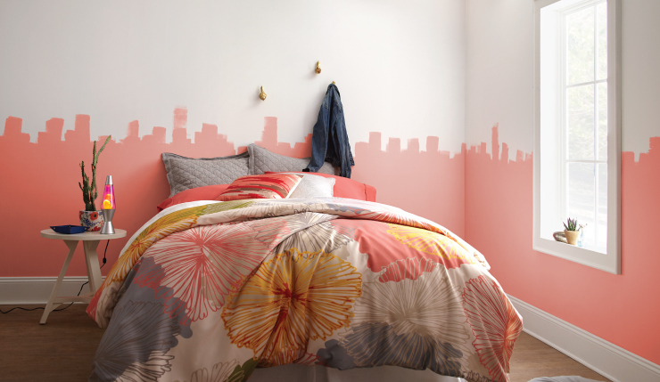 A bedroom with the bottom half of the wall painted in Guava Jelly.