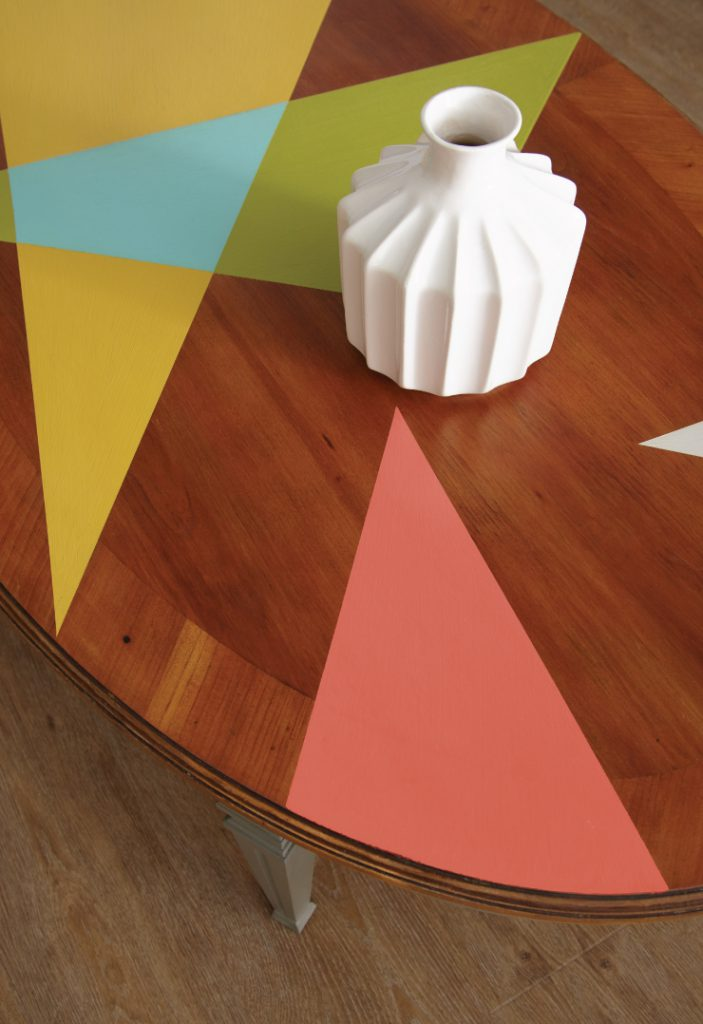 A table with triangle shapes painted in multiple colors.