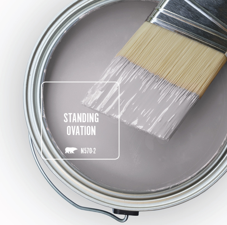 An open paint can overview with wet paint tinted a light purple color called Standing Ovation.