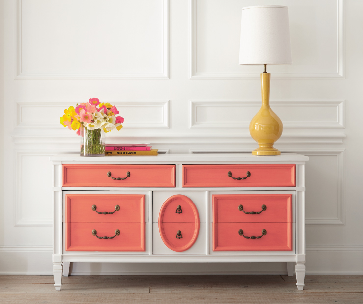 A dresser showing the top panel of the drawers painted in Guava Jelly.