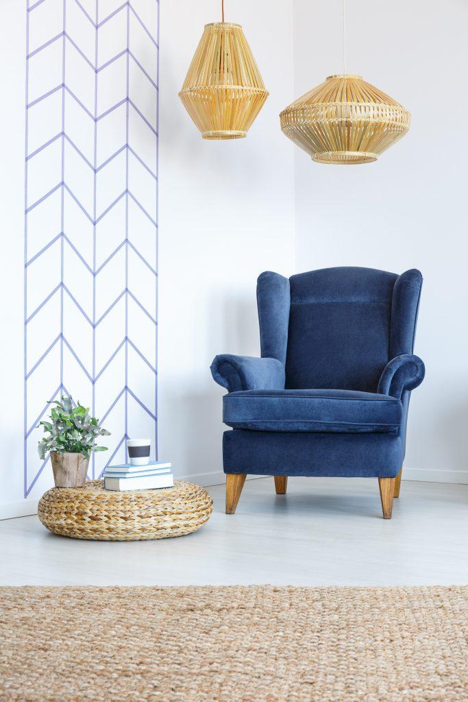 A blue velvet decorative chair.