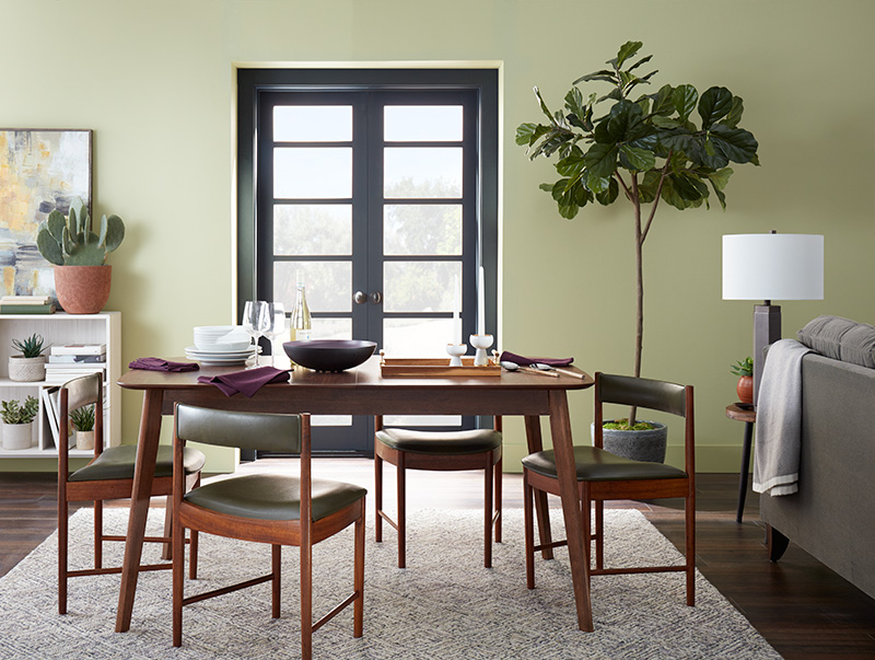 A dining are with the walls painted in Back to Nature.