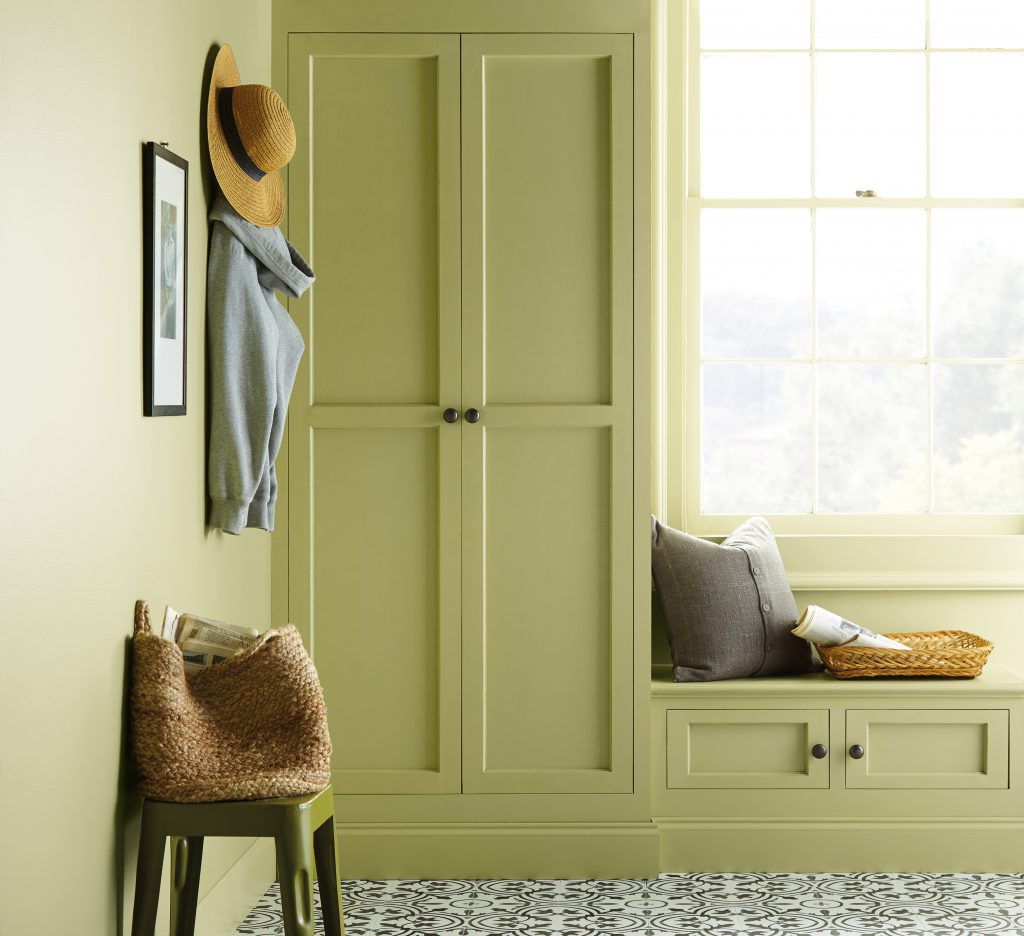 A small reading area with a window seat. The wall is painted in Back to Nature.