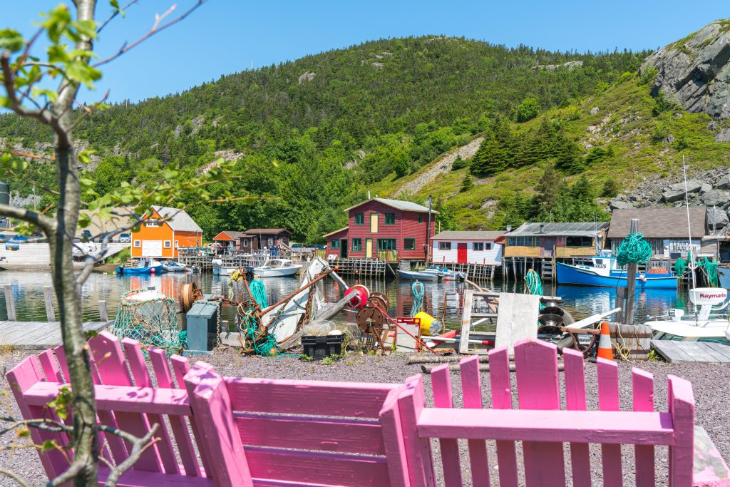 A view of trash art for St. John's showing oars and rope. Two pink chairs are in the foreground of the image.