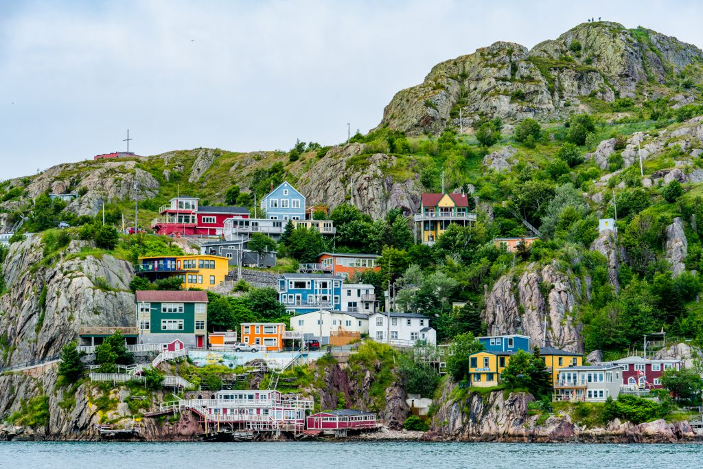 A view of St. John's, Newfoundland showing colorful houses on a hillside along the water.
