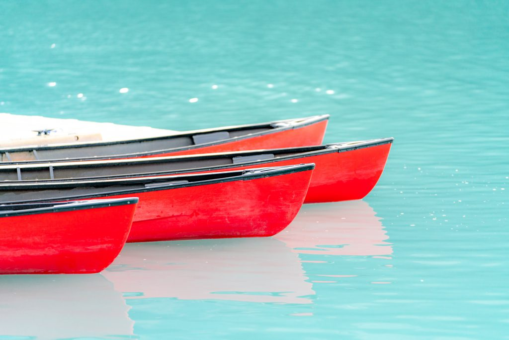 A close up view of red canoes.