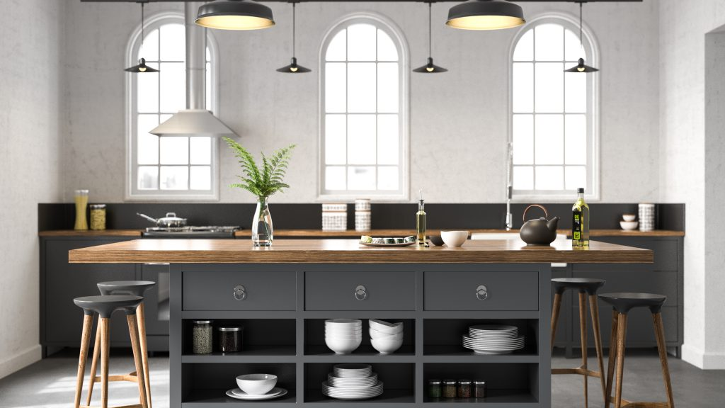 A dark gray industrial kitchen showcasing cabinets and kitchen island.