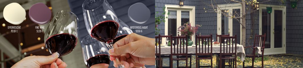 Paint colors drops shown: Effervescent (soft yellow), Fine Wine (plum), Mysterious Night (purple). Three paint drops placed on top of a picture of people holding wine glasses up to cheer. In the background you can see part of an exterior home that is painted in Mysterious Night. To the right of this image is an exterior home and outdoor dinner setting. Home is painted in Mysterious Night. The trim of the home is Effervescent. The chairs placed at the table is the color Fine Wine.