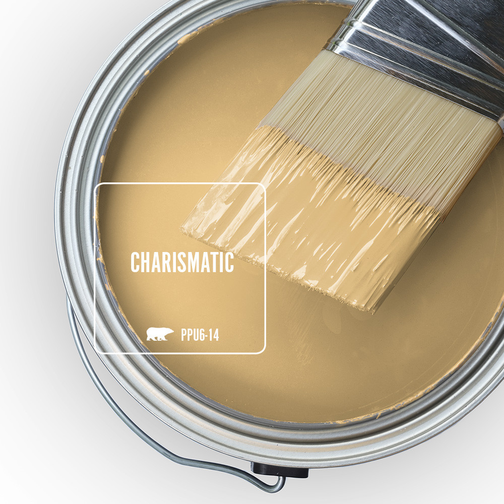 An open can overview featuring wet paint tinted in yellow color called Charismatic.