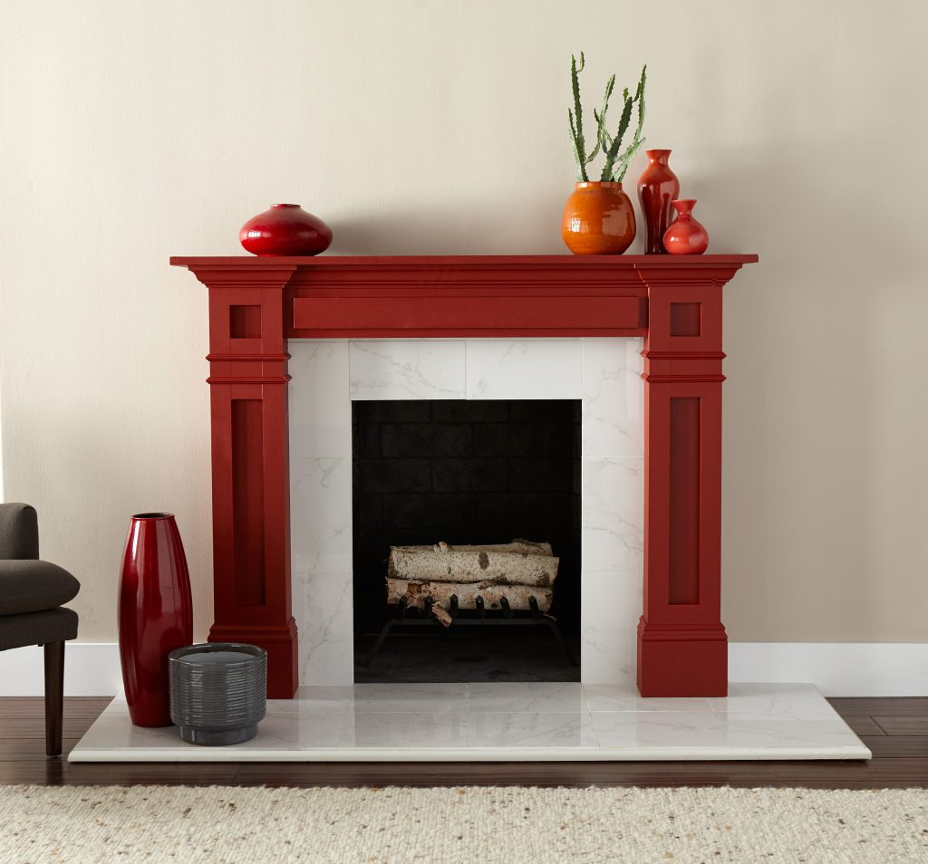An interior living area featuring a fireplace painted in red color called Red Pepper.