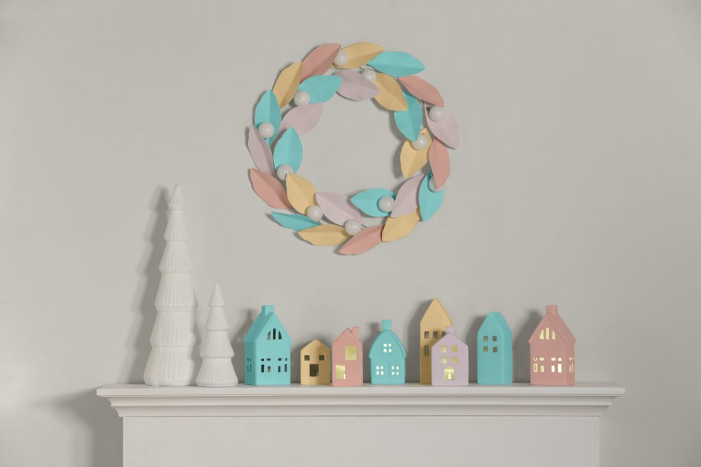 A winter wonderland theme fireplace mantle, all decorated with pastel colors.