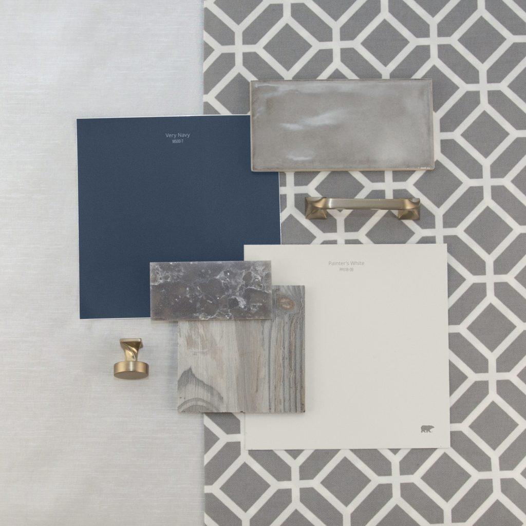 This is an inspirational photo on how to furnish your kitchen. There are two peel n stick swatches in Very Navy and Painter's White. These are paired with a gray wood swatch for flooring, dark gray sparkle granite swatch, and a light gray tile backsplash, there is also a knob for cabinets and a handle for cabinets, each are in a chrome tone.  Behind the materials is fabric laid out in a very light gray tone and other fabric is a hexagonal pattern.