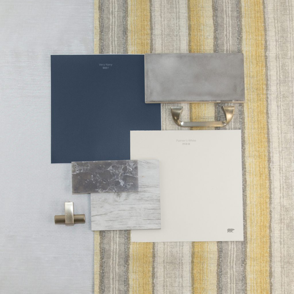 This is an inspirational photo on how to furnish your kitchen. There are two peel n stick swatches in Very Navy and Painter's White. These are paired with a light white-gray wood swatch for flooring, dark gray sparkle granite swatch, and a light gray tile backsplash, there is also a knob for cabinets and a handle for cabinets, each are in a chrome tone.  Behind the materials is fabric laid out in a very light gray tone and other fabric has vertical stripes in gray, cream and yellow.