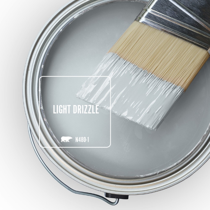 An open paint can overview featuring a light  blue color called Light Drizzle.