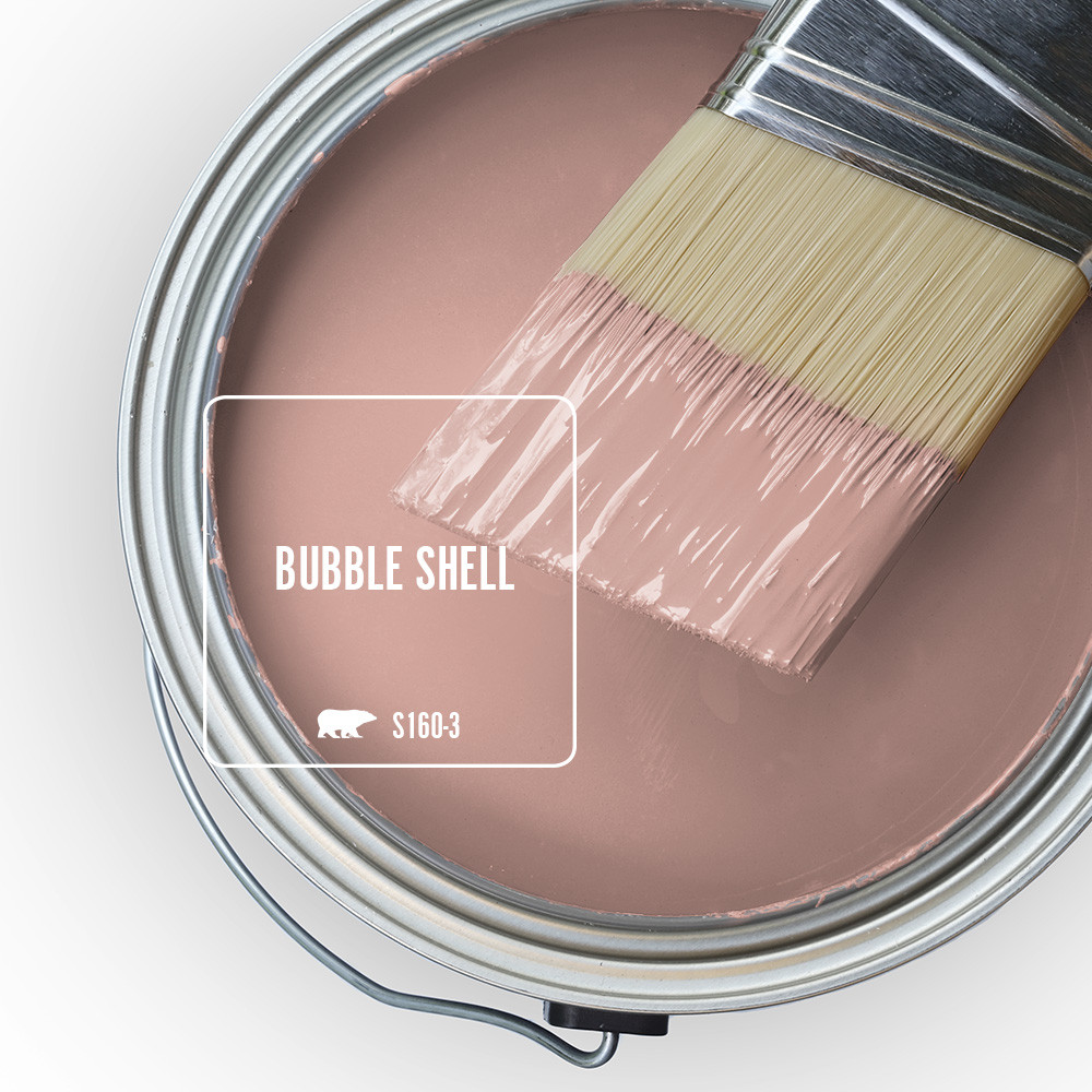 An open paint can overview with wet paint in a light pink color called Bubble Shell.
