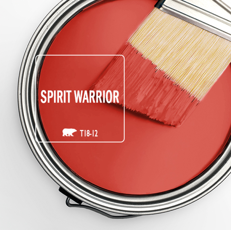 This image shows an open paint can with Spirit Warrior and a paint brush with paint on it.