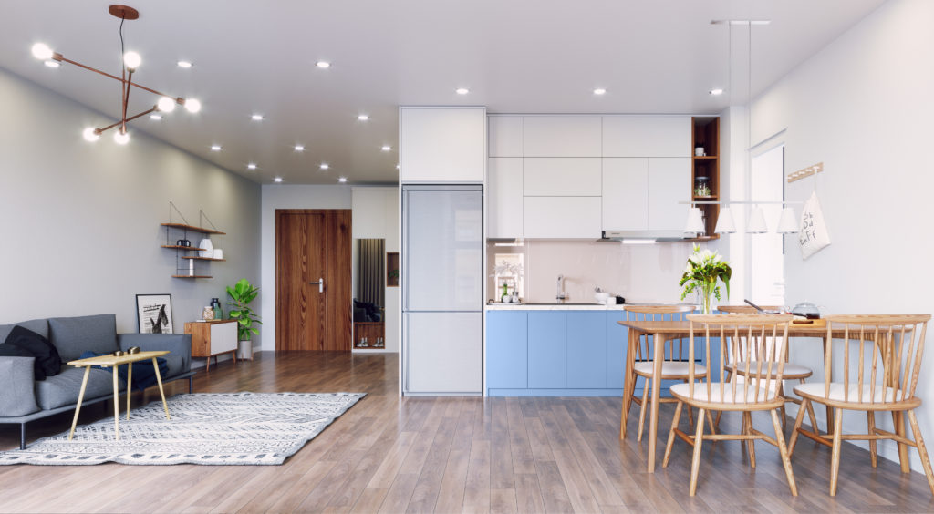 An open floor apartment with living, dining areas and a kitchenette, lower cabinets are painted a blue color called Bluebird.