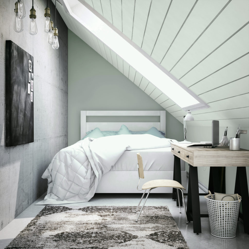 A bedroom with a low slanted ceiling