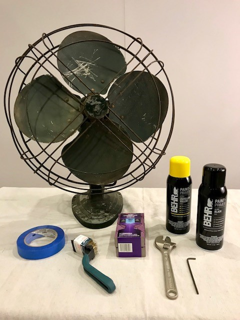 Prep and painting materials to complete a vintage cooling fan make- over project.