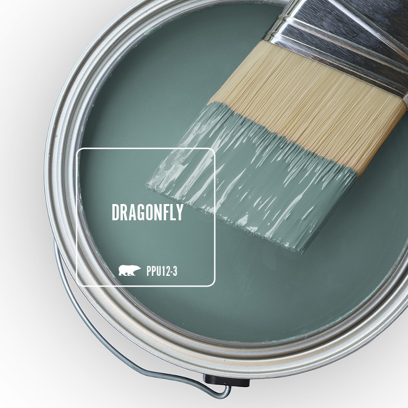 The top view of an open paint can and paint brush.