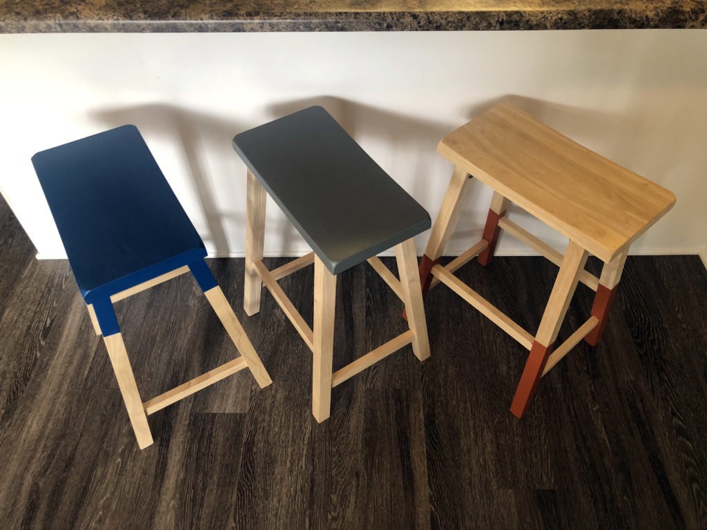 This image is the finished look of all three stools beneath a kitchen bar.