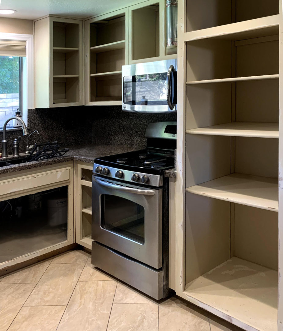 image showing kitchen with the cabinets removed.