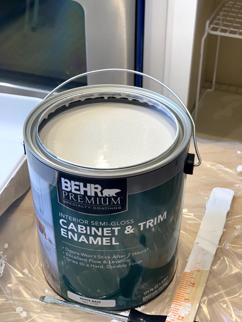 can of paint with the lid off.