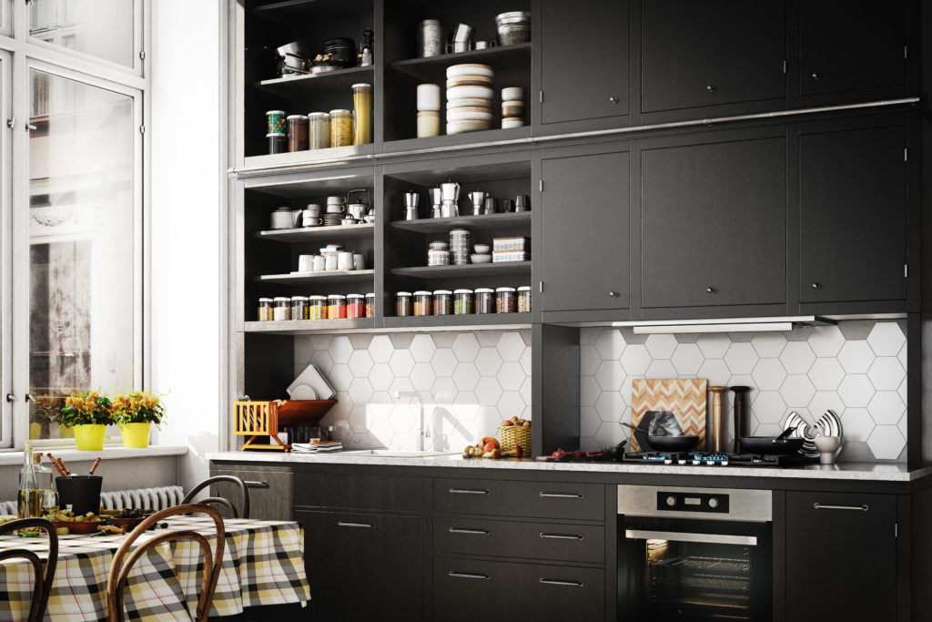 A Scandinavian style kitchen with trendy black cabinets. The matte finish on the black cabinets creates elegance and depth to the room.