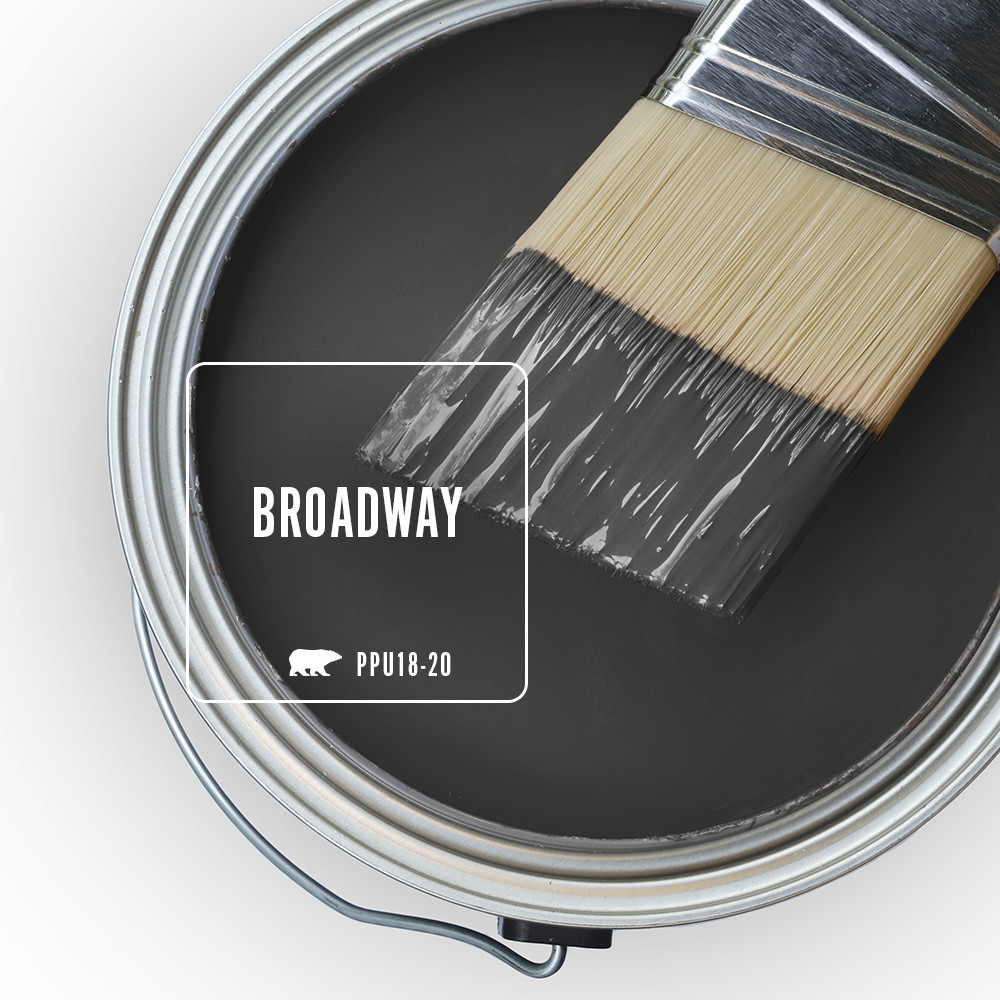 An open paint can top view featuring a black color called Broadway.