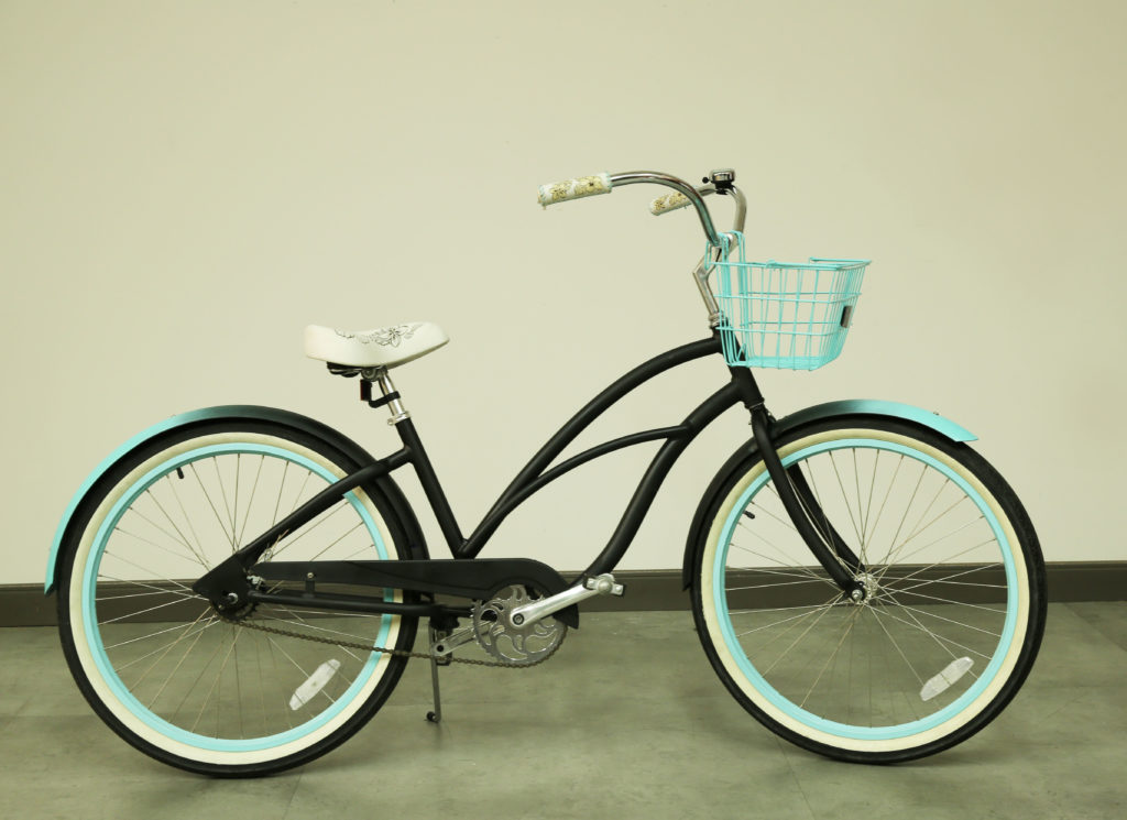 Bicycle painted in Black and Light Blue, side view.