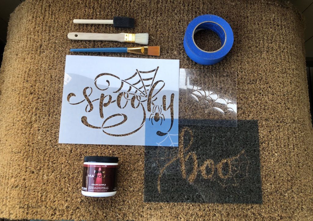 This image shows the materials needed for this fun project.  Stencils Painters Tape Paint Brushes Coir Doormat and Paint color or colors of choice