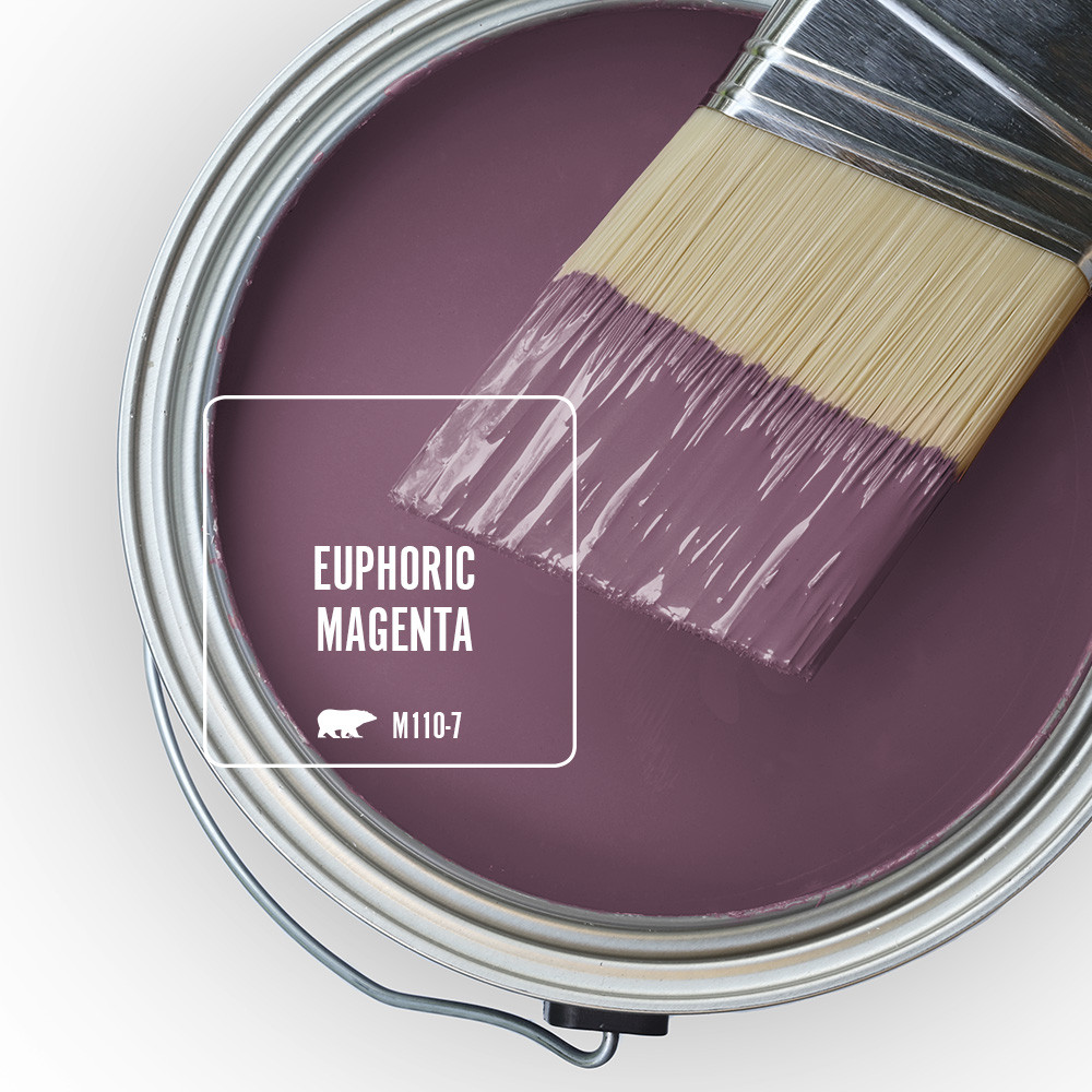 The top view of an open paint can with a half-dipped brush sitting on top of t, the wet paint color is called Euphoric Magenta.