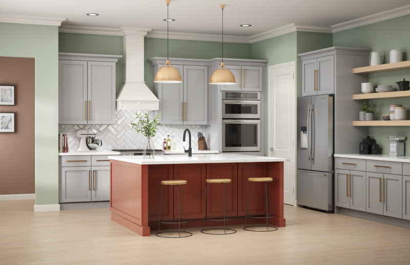 A modern farmhouse kitchen painted in a hazy green color called Jojoba, the focal point of this room is the kitchen island which is painted in a dark orange called Kalahari Sunset.