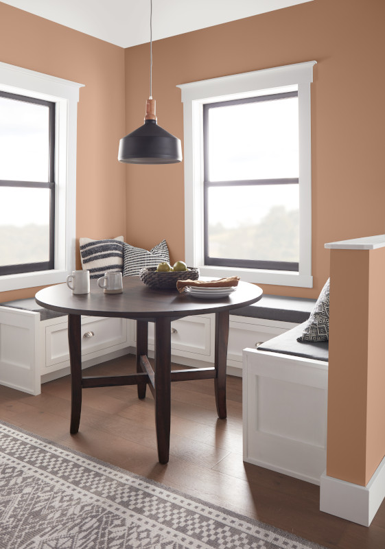 A cozy breakfast nook, the walls are painted in a terracotta neutral color called Canyon Dusk.