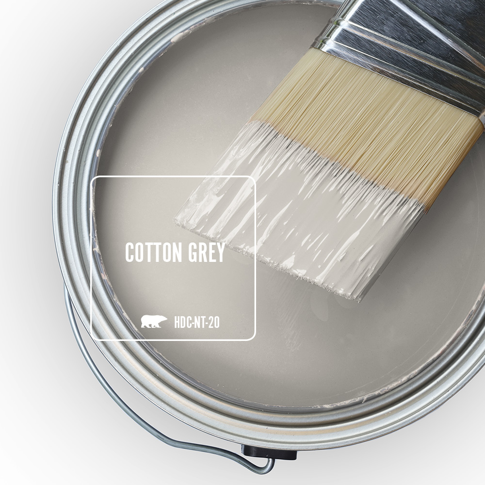 An open paint can showing the color Cotton Grey (light gray) inside the can.