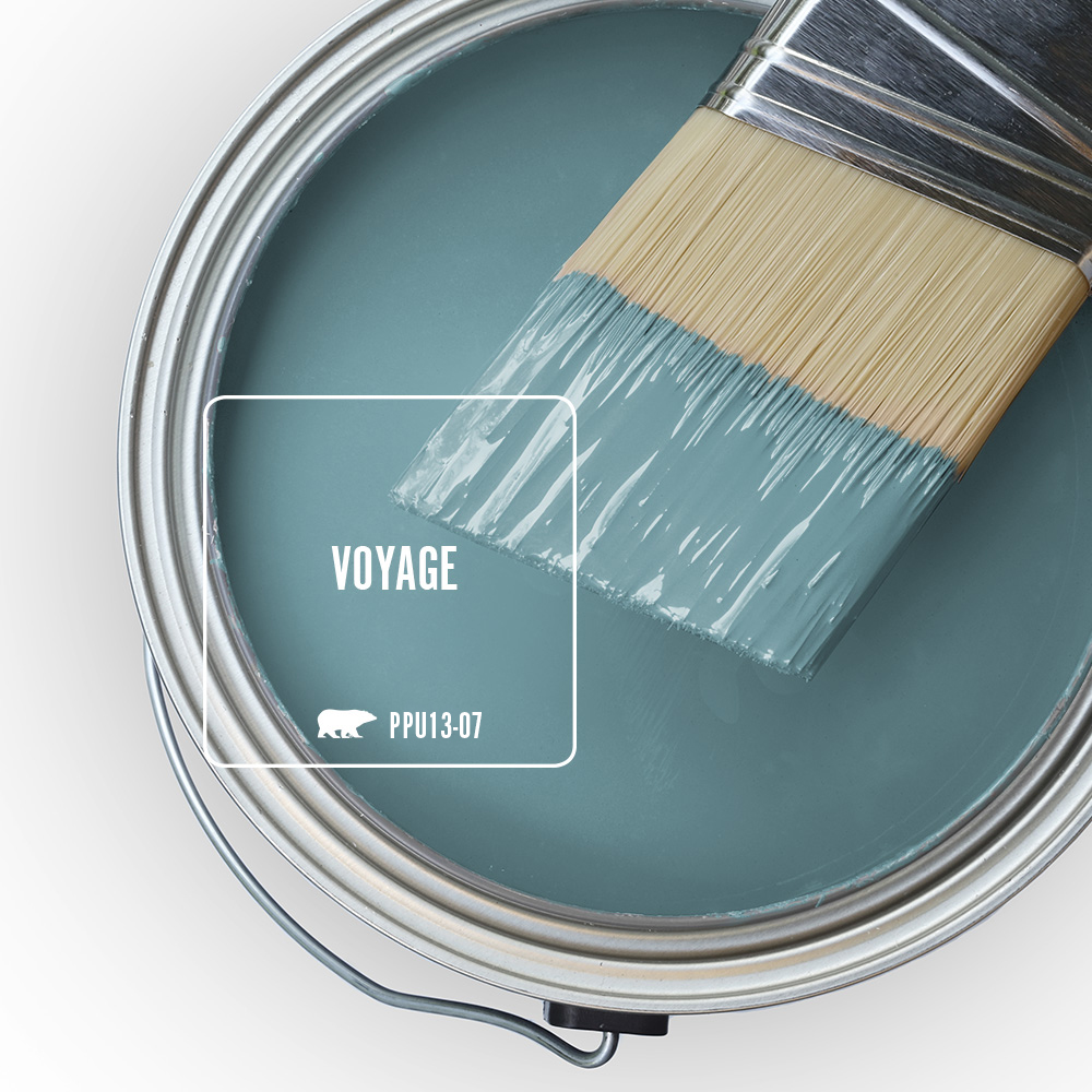 An open can overview with a halpf dipped paint blue, the featured blue color is called voyage.