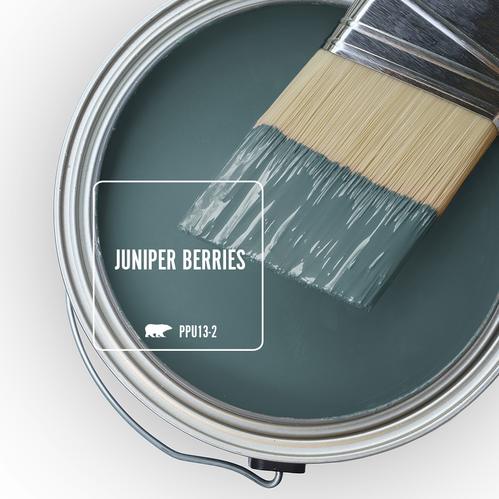 An open paint can showing the color Juniper Berries (green-blue) inside the can.