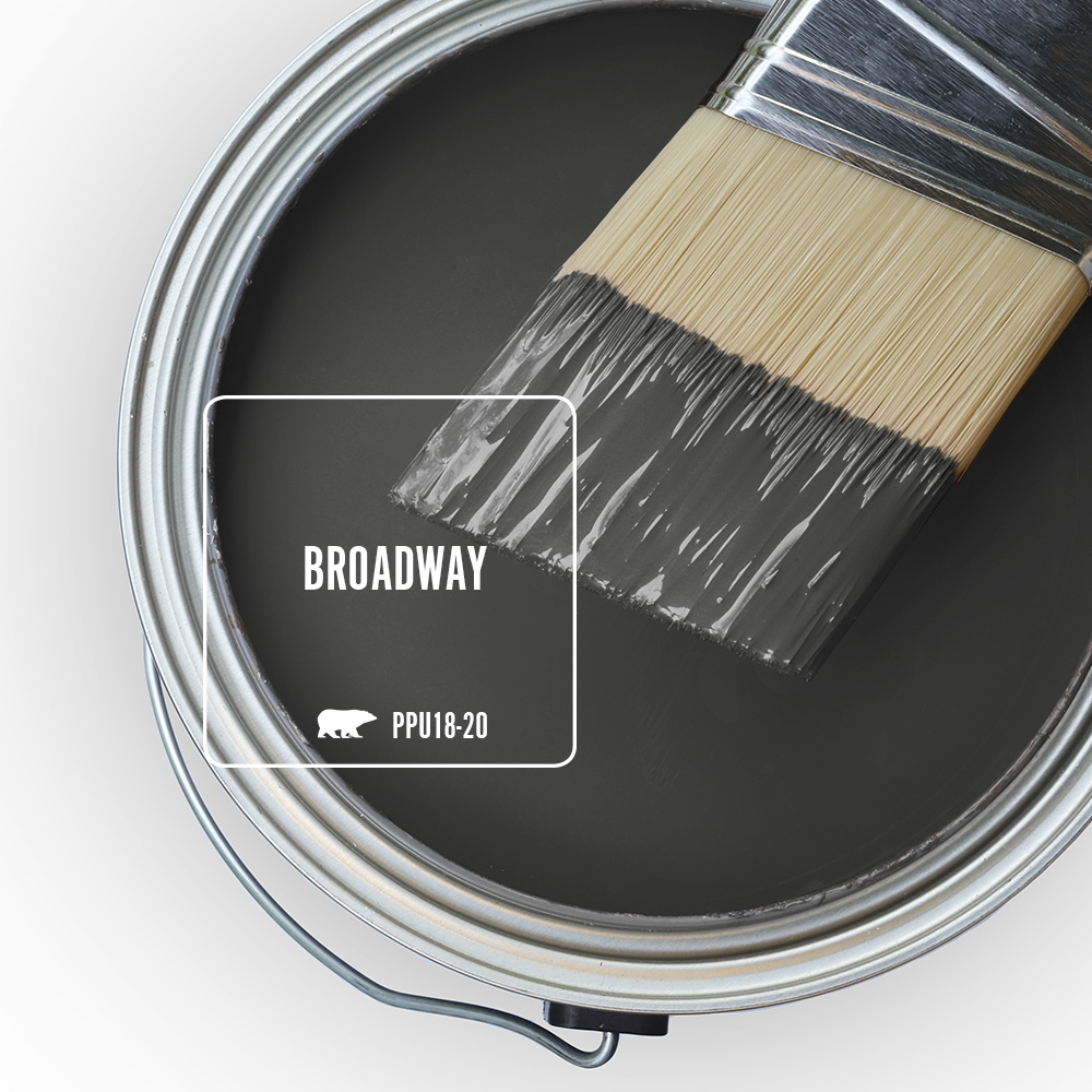 An open paint can showing the color Broadway (black) inside the can.