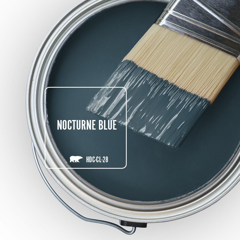 The top view of an open paint can featuring a dark blue color called Nocturne Blue