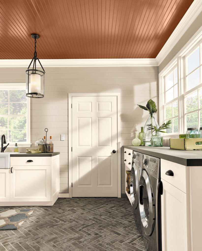 A laundry room painted in a light neutral colors which make the overall room feel expansive and bright.  The ceiling painted color is a mid-to-dark warm tone called Maple Glaze.