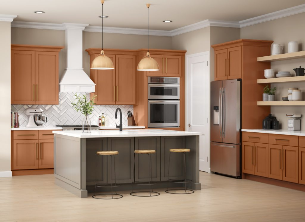 A large kitchen with a lot of cabinetry storage.  The cabinetry are painted in a tera cotta tone called Maple Glaze.  Kitchen Island is paint in a gray tone color called Barnwood Gray.
